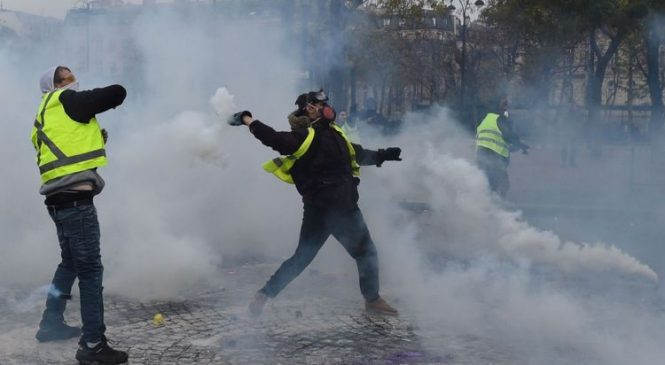 France abandons petrol price hikes in response to violent protests