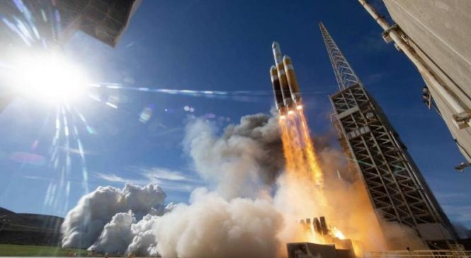 Spy satellite launched after repeated delays