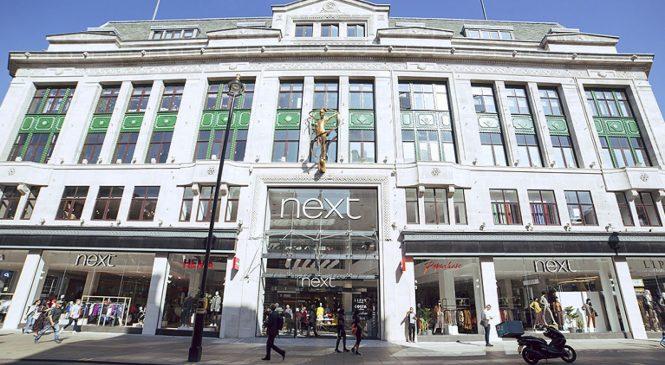 Next trims profit forecast to £723m