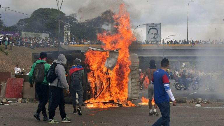 A van is set on fire by Venezuelan opposition demonstrators