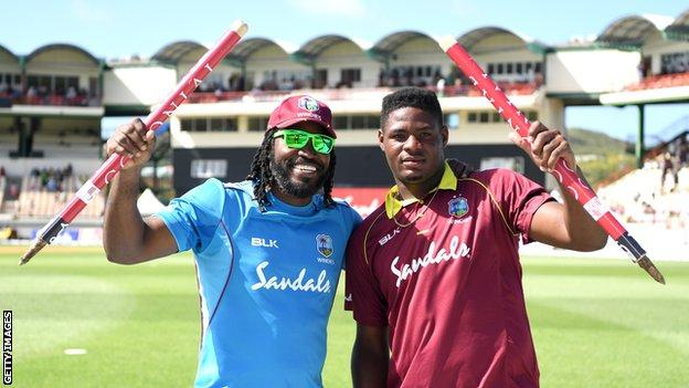 West Indies players Chris Galye (left) and Oshane Thomas (right) hold up a stump each after victory over England