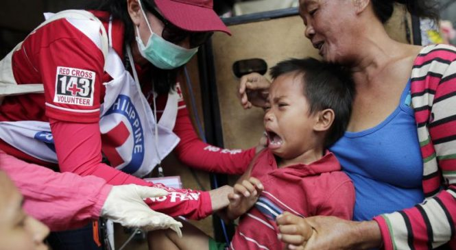 Philippines charges ex-health secretary in connection to vaccine deaths