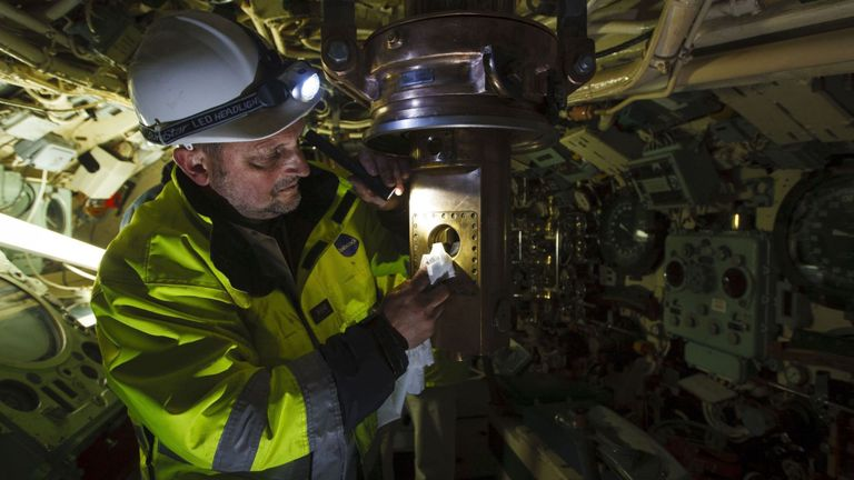 Harry MacCallum from Babcock International Group inspects the bronze attack periscope after being carefully returned to HMS Alliance at the Royal Navy Submarine Museum in Gosport, Hampshire