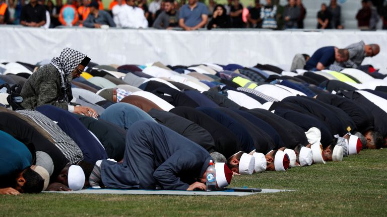 People perform Friday prayers a week after the shooting