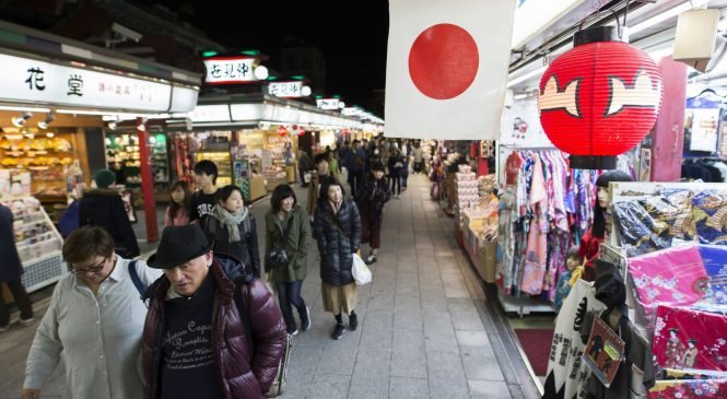 Japan's inflation edges higher but its central bank is still in a bind
