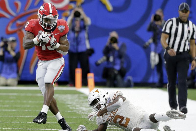 Panthers sign RB Elijah Holyfield, boxing legend's son