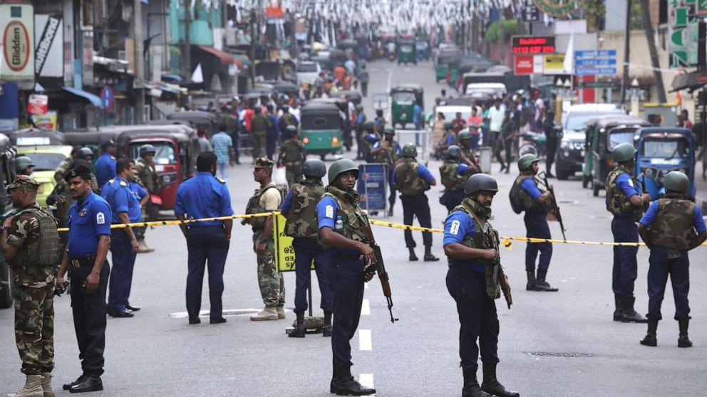 Militants set off bombs during Sri Lanka raid, killing 15