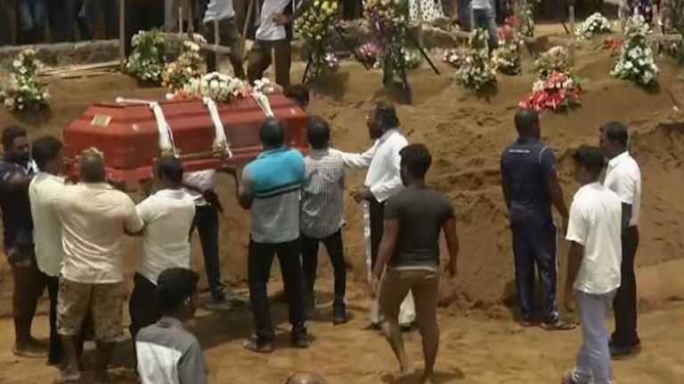 Mass burials are carried out in Sri Lanka following terrorist bombings