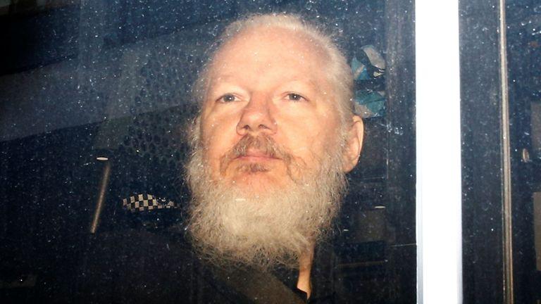 WikiLeaks founder Julian Assange in a police van