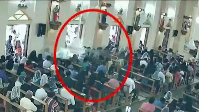 The moment the suspected bomber enters the church
