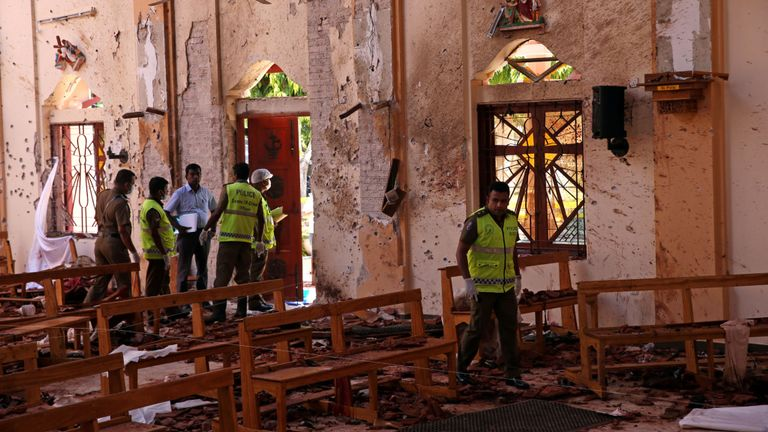 Police officers work at the scene at St. Sebastian Catholic Church, after bomb blasts ripped through churches and luxury hotels on Easter, in Negombo, Sri Lanka April 22, 2019