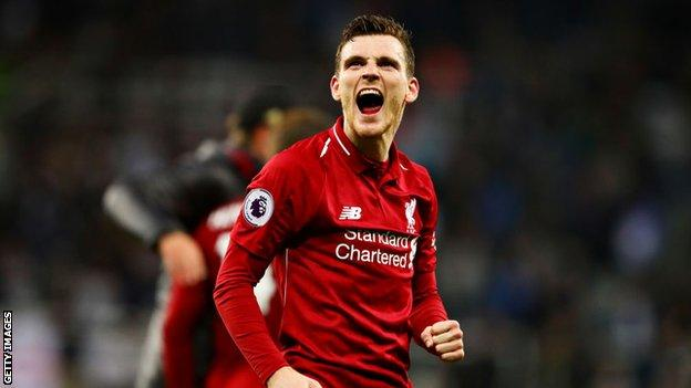 Liverpool left-back Andrew Robertson celebrates after victory over Newcastle
