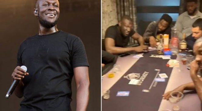 Stormzy pictured at table with bag containing mysterious substance