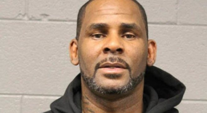 R Kelly charged with 11 new counts of sex abuse with victims aged 13 to 16