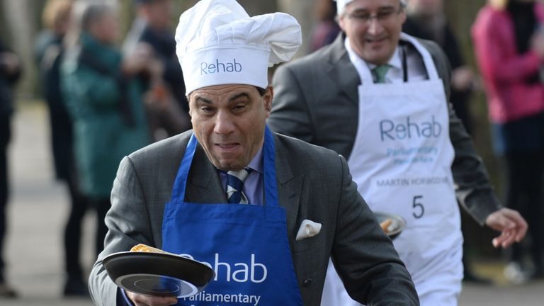 Lord Bilimoria (front, left) and Martin Horwood MP (back, right) take part in the annual Rehab Parliamentary Pancake Race in 2014