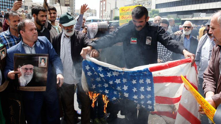 Iranian demonstrators burn a makeshift US flag during a rally in the capital Tehran