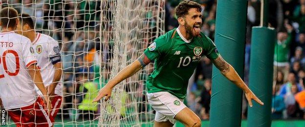 Robbie Brady wheels away in celebration after scoring Ireland's second goal