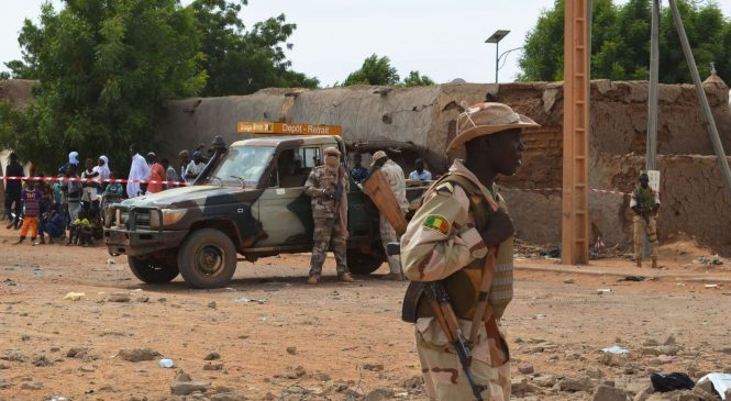 At least 95 killed in attack on Mali village as bodies are burned