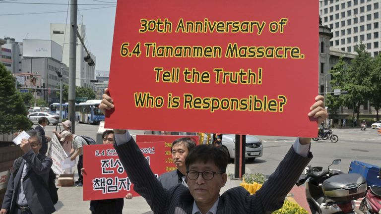 A South Korea protester in Seoul calls for 'truth' over the crackdown
