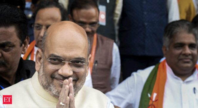 Shah receives Rs 15.26 crore dividend cheque on MHA's shares in Repco Bank