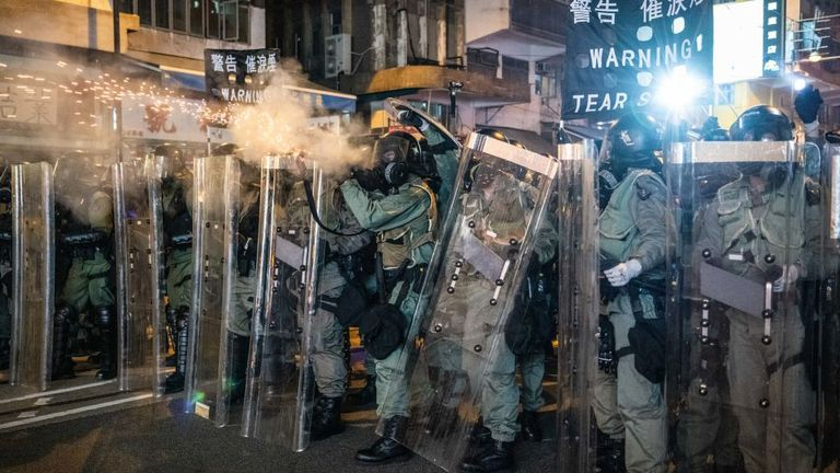 Black banners warned protesters to expect tear gas