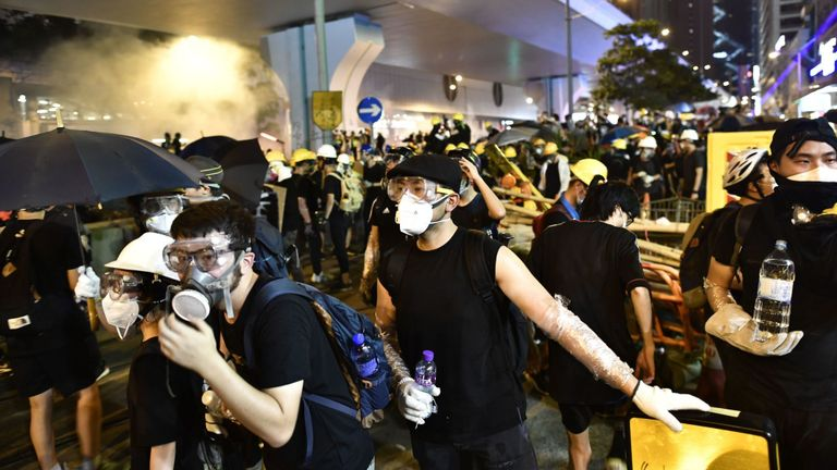 Many protesters wore gas masks and helmets
