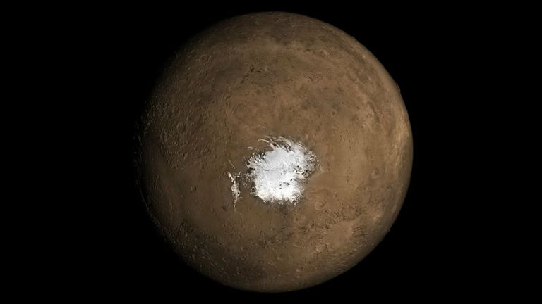 The Martian South Pole. A new study in Geophysical Research Letters argues there needs to be an underground source of heat for liquid water to exist underneath the polar ice cap. Credit: NASA.