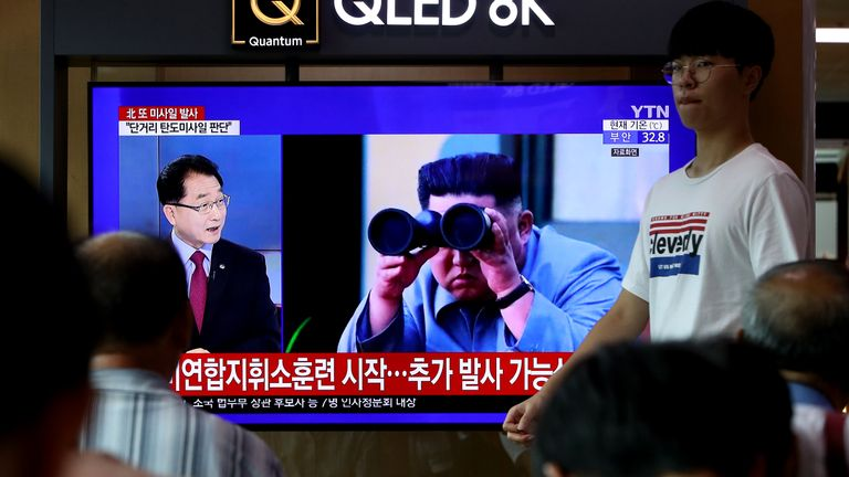 SEOUL, SOUTH KOREA - AUGUST 10: People watch a TV showing a file image of a North Korean missile launch at the Seoul Railway Station on August 10, 2019 in Seoul, South Korea. Today's launch came just four days after North Korea fired two projectiles believed to be the newly developed short-range ballistic missiles. It is also the fifth such launch since July 25, when it also fired two short-range missiles. (Photo by Chung Sung-Jun/Getty Images)