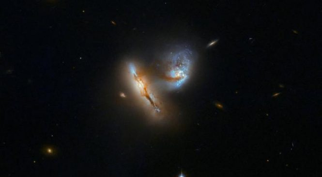 Hubble photographs playful galactic duo