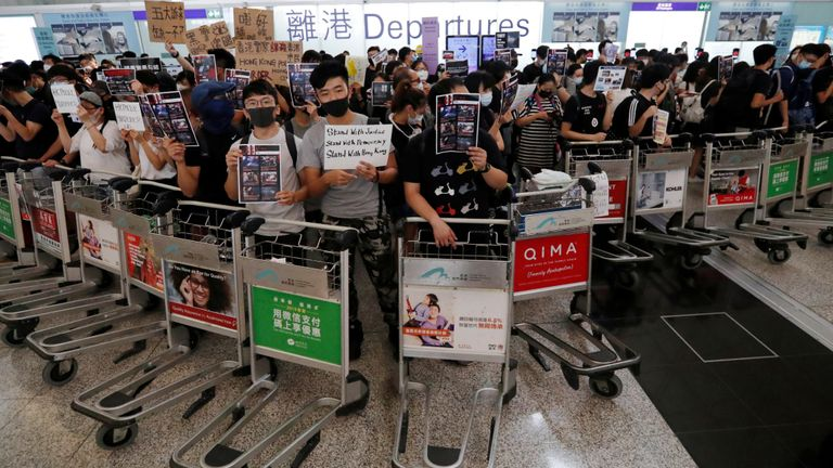 Protesters barricaded themselves in with luggage trolleys