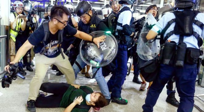 Hong Kong 'on path of no return' as violent protests hit busy airport
