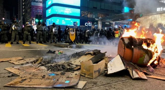 Police fire rubber bullets at Hong Kong protesters