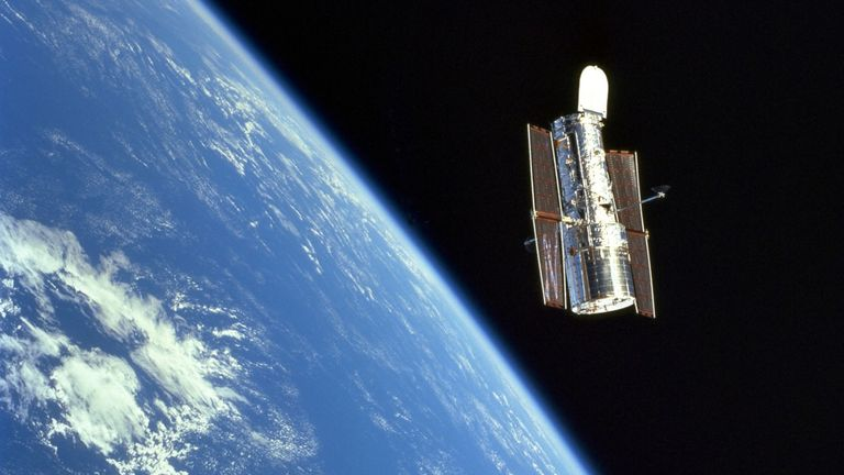 Scientists used data from the Hubble space telescope, seen here floating above the Earth. Pic: NASA/ESA