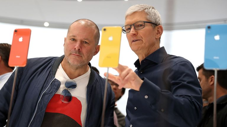 Jony Ive (L) and Apple CEO Tim Cook inspect the new iPhone XR in 2018