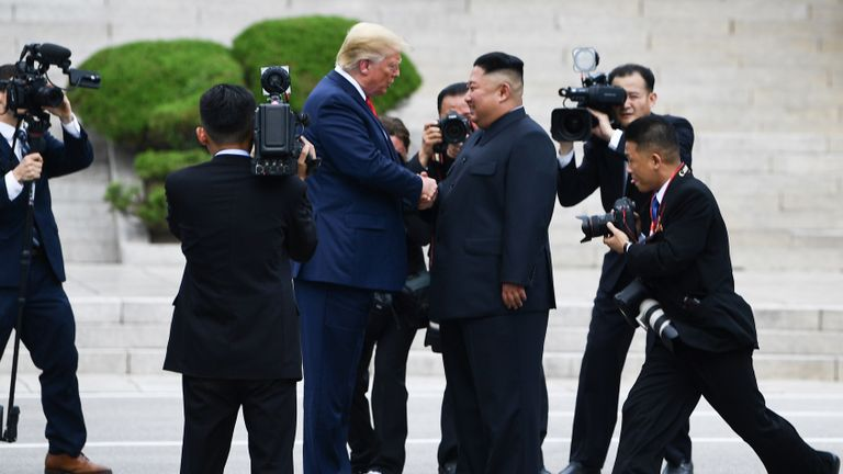 North Korea's leader Kim Jong Un shakes hands with US President Donald Trump north of the Military Demarcation Line that divides North and South Korea, in the Joint Security Area (JSA) of Panmunjom in the Demilitarized zone (DMZ) on June 30, 2019. (Photo by Brendan Smialowski / AFP)        (Photo credit should read BRENDAN SMIALOWSKI/AFP/Getty Images)