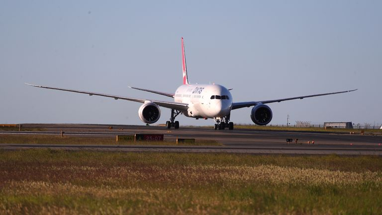 """SYDNEY, AUSTRALIA - OCTOBER 20: Qantas flight 7879 lands at Sydney Airport after flying 19 hours and 16 minutes from New York to Sydney on October 20, 2019 in Sydney, Australia. Qantas is the first commercial airline to ever fly direct from New York to Sydney. The flight was restricted to 40 people plus 10 crew to increase aircraft range, and included medical scientists and health experts on board to conduct studies in the cockpit and the cabin to help determine strategies to promote long haul inflight health and wellbeing on ultra-long haul flights. It comes as the national carrier continues to work towards the final frontier of global aviation by launching non-stop commercial flights between the US and the UK to the east coast of Australia in an ambitious project dubbed """"Project Sunrise"""". (Photo by James D. Morgan/Getty Images for Qantas)"""
