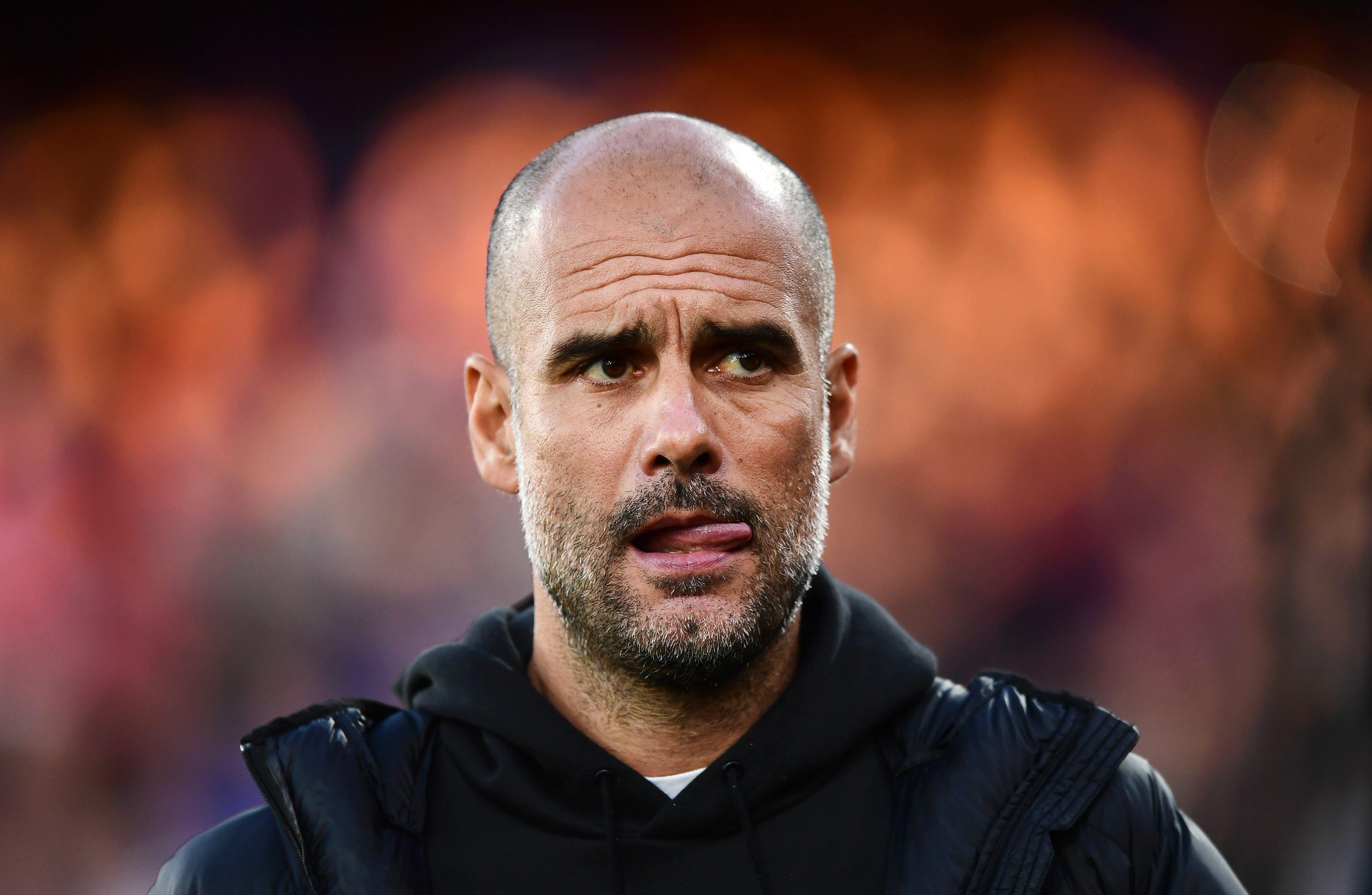 Pep Guardiola's side beat Crystal Palace 2-0