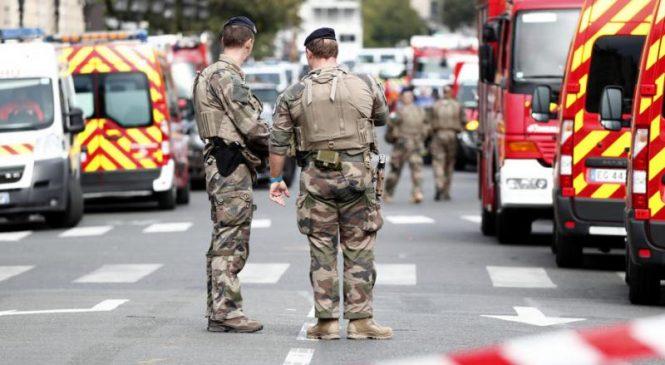 Paris police attack suspect had 'radical' belief, witnesses say