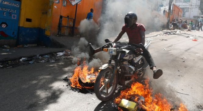 Thousands of protesters in Haiti loot stores, battle police