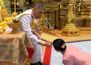 Thai king strips consort of titles for 'disloyalty'