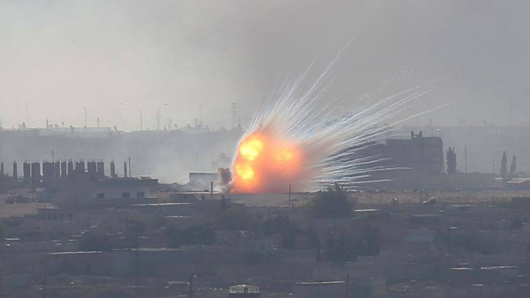 An explosion is seen over the Syrian town of Ras al-Ain as seen from the Turkish border town of Ceylanpinar