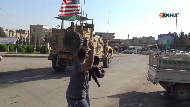 Syrians threw potatoes and yelled at U.S. armoured vehicles as U.S. troops drove through the northeast border town of Qamishli.