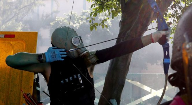 Hong Kong protesters set fire to university entrance to stop police getting in