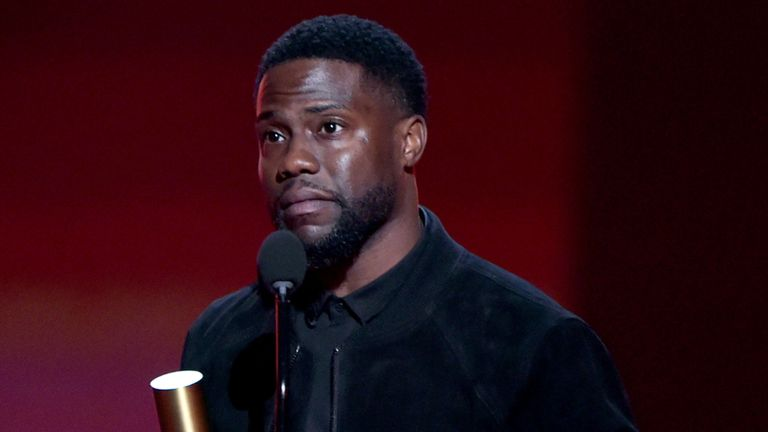 Kevin Hart accepts The Comedy Act of 2019 award on stage for 'Kevin Hart: Irresponsible' on stage during the 2019 E! People's Choice Awards. Pic: E! Entertainment