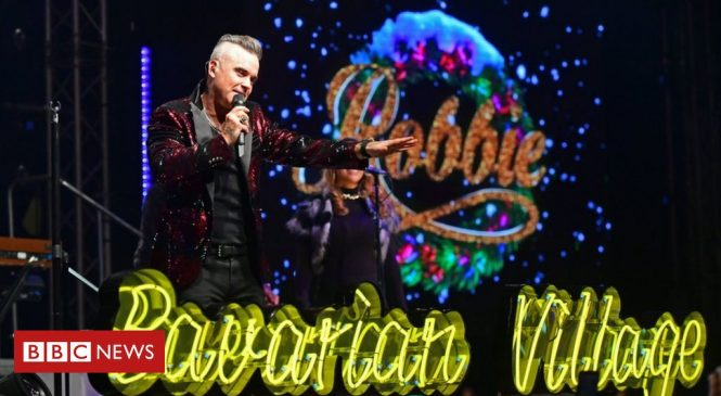 Robbie Williams hits number one and equals Elvis Presley's UK chart record