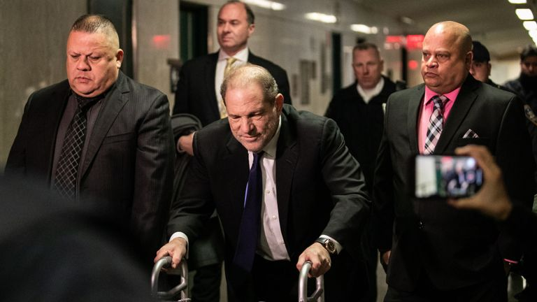 Harvey Weinstein arrives at court for a bail hearing on Wednesday on a zimmerframe