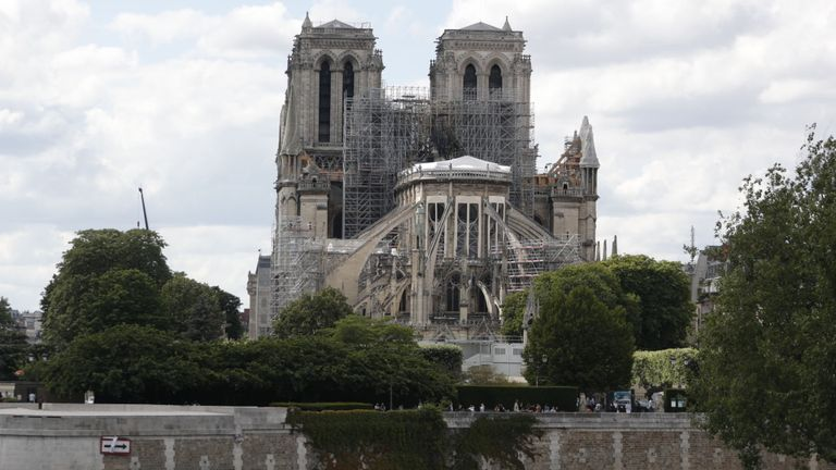 A view of the Notre-Dame de Paris cathedral seen on June 15, 2019. - The Notre-Dame cathedral in Paris will host its first mass on June 15, 2019, exactly two months after the devastating blaze that shocked France and the world. For safety reasons, the mass led by Archbishop of Paris Michel Aupetit will be celebrated on a very small scale. Worshippers will be expected to don hard hats but priests will be wearing their ceremonial garb. (Photo by Zakaria ABDELKAFI / AFP) (Photo credit should read Z