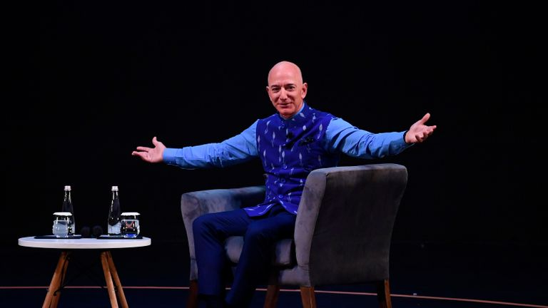 CEO of Amazon Jeff Bezos (R) gestures during the Amazon's annual Smbhav event in New Delhi on January 15, 2020. - Bezos, whose worth has been estimated at more than $ 110 billion, is officially in India for a meeting of business leaders in New Delhi. (Photo by Sajjad  HUSSAIN / AFP) (Photo by SAJJAD  HUSSAIN/AFP via Getty Images)