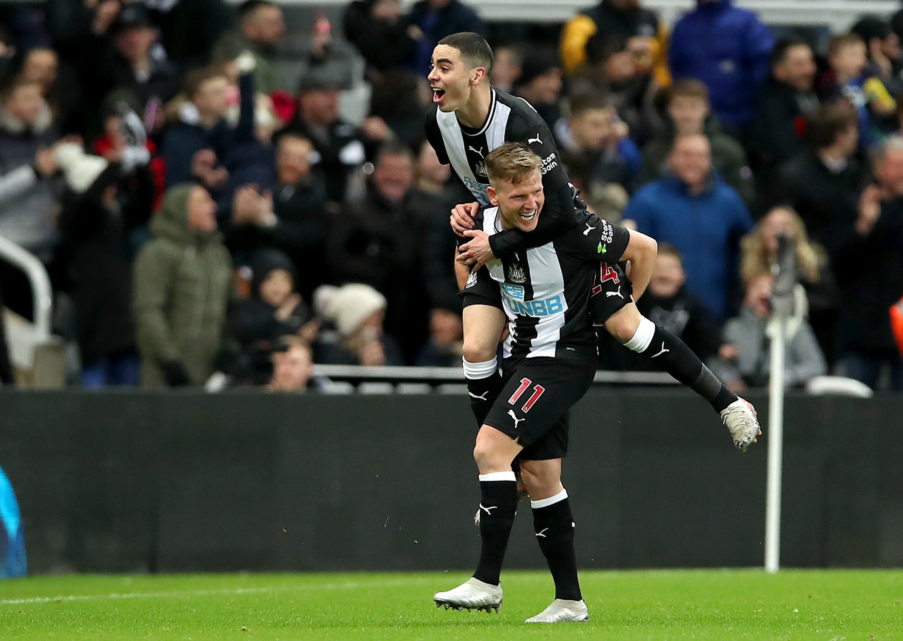 Miguel Almiron and Matt Ritchie celebrate a Newcastle goal