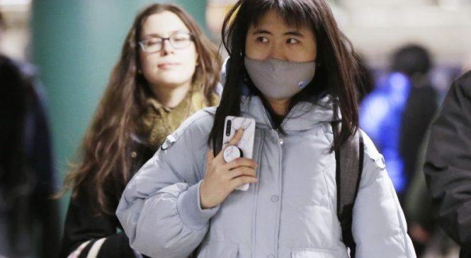 U.S. expands coronavirus screenings, United suspends some flights to China